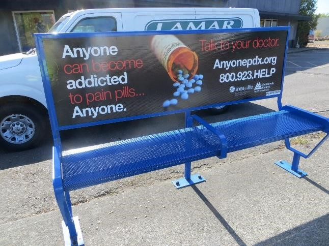 Picture of  Portland transit bus station bench with anyone pdx campaign on it
